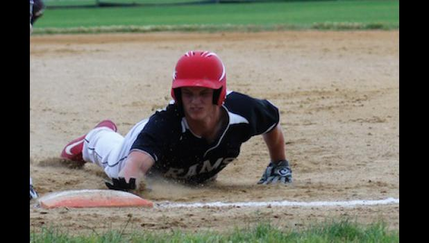 Riah Nelsen dives back to first base to avoid getting put out in the Rams 4-0 win over PCM at Allensworth Field. Nelsen drove in three of the team's four runs and hit his first home run of the season.