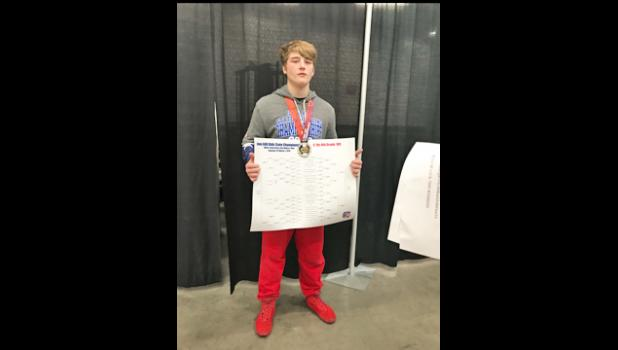 Greene County eighth-grader Michael Rumley is pictured holding his AAU state wrestling bracket while donning a championship medal after winning the title March 1. PHOTO SUBMITTED
