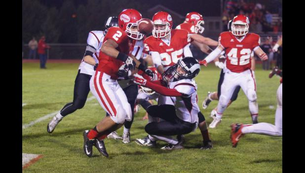 Chase Stoline pops the out of  Toreador Jayden Tedrow's grasp during the fourth quarter of Greene County's 52-23 victory. The Rams only gave up 66 rushing yards in the game and also forced four turnovers.