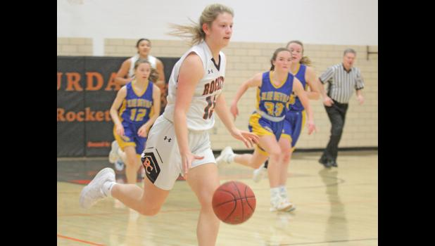 Paton-Churdan's Tessa Steimel (with ball) dribbles up court during the Rockets' 62-41 win over Martensdale-St. Mary's Feb. 16 in a Class 1A regional quarterfinal Churdan. P-C will take on CAM Friday, Feb. 19 in the regional semifinals.  BRANDON HURLEY | JEFFERSON HERALD