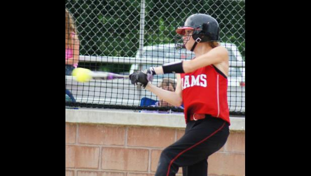 Sydney Koch smashes a triple in the seventh inning of the Rams game with Colfax-Mingo. Carleigh Paup connected for a single and drove Koch in for a Ram 1-0 victory over the Tigerhawks.
