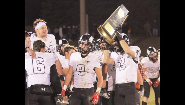Members of the Greene County football team hoist their state participant trophy following the Rams' 48-15 loss to Algona in the 2A quarterfinals Friday, Nov. 8.  BRANDON HURLEY | JEFFERSON HERALD