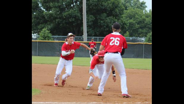 Sophomore Tyler Beger runs down a Harlan player who gets caught between first and second base. The Rams had a good effort, but couldn't get any of their runners across the plate and lost 3-0.