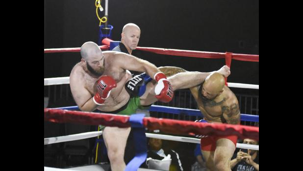 Jefferson-Scranton graduate Graham Smith (left) defeated Houston Alexander by unanimous decision in his professional kick-boxing debut Oct. 19 at Wild Rose Casino.  PHOTO BY ERIC NICESWINGER
