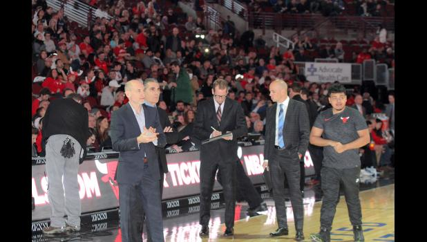 Toronto Raptors assistant Nate Bjorkgren (right), a Storm Lake High School graduate, talks with fellow Iowan and Raptors head coach Nick Nurse (middle) prior to a game this winter in Chicago.  BRANDON HURLEY | DAILY TIMES HERALD