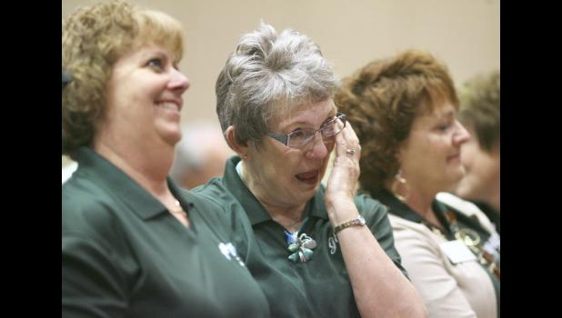 Mary Jane Field (right), a former Greene County supervisor; wipes a tear from the corner of her eye following today's 3-2 vote by the Iowa Racing and Gaming Commission to grant Wild Rose Entertainment and Grow Greene County a license to build a casino in Jefferson. Joining Field at the hearing held in Burlington is Brenda Muir (left).