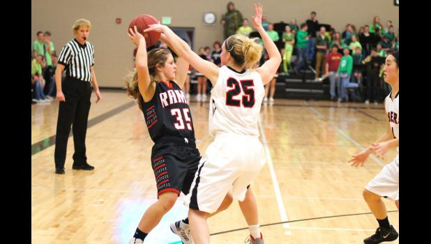 Gilbert's Taylor Broshar attempts to block Emily Christensen's pass in the Rams game versus Gilbert on Jan. 3. The Rams were up by nine at half time, but the Tigers out scored the Rams 19-5 in the final period and won the game 40-34.