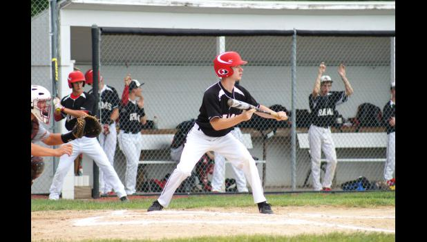 Colton Fitzpatrick squares to bunt in last Friday's conference game versus PCM. Fitzpatrick was the winning pitcher, giving up only three hits and no runs.