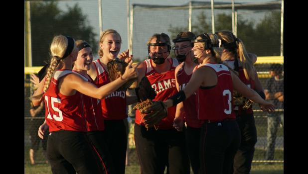 Several Ram players celebrate seconds after winning their way back to the state softball tourney.