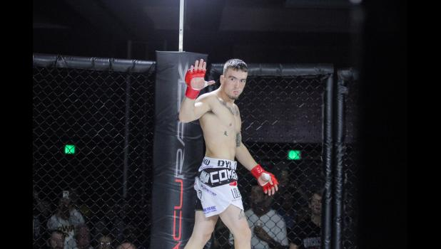 Paton-native Dylan Forkner waves to the crowd prior to his professional MMA debut Saturday, Oct. 20 at Wild Rose Casino. The former Greene County Ram won by TKO of Nathan Endres 35 seconds into the opening round.  BRANDON HURLEY | JEFFERSON HERALD