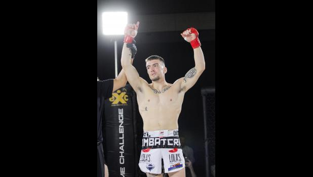 Paton-native Dylan Forkner strikes a poses following victory in his professional MMA debut Saturday, Oct. 20 at Wild Rose Casino. The former Greene County Ram won by TKO of Nathan Endres 35 seconds into the opening round.   BRANDON HURLEY | JEFFERSON HERALD