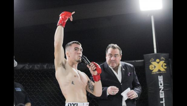 Paton-native Dylan Forkner addresses the hometown crowd following his professional MMA debut Saturday, Oct. 20 at Wild Rose Casino. The former Greene County Ram won by TKO of Nathan Endres 35 seconds into the opening round.  BRANDON HURLEY | JEFFERSON HERALD