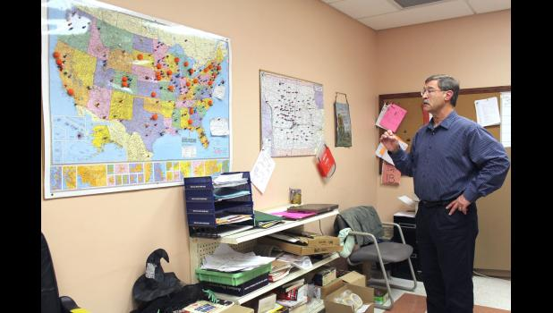 Terry Johnson, Genesis Development's CEO, discusses maps that show where throughout Iowa and the United States the organization has shipped cardboard boxes made by Custom Boxes Online. The Jefferson-based company has sent boxes to all 50 states, Europe, South America, Guam and the U.S. Army in Iraq.