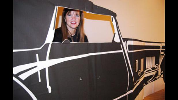 Still in the driver's seat: Teresa Green, a business education teacher at Greene County High School, has coordinated the prom as junior class adviser for 33 years, including Saturday's 1920s-themed event.