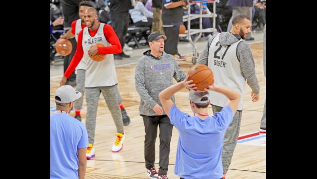 Toronto Raptors head coach and 1985 Kuemper Catholic graduate Nick Nurse (middle with hat) directs the Team Giannis All Star practice Saturday, Feb. 15 in Chicago. Nurse was head coach in Sunday's All Star Game, where his team fell by a narrow margin, 157-155.  BRANDON HURLEY | TIMES HERALD