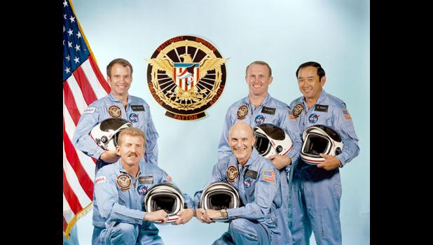Official portrait of the STS-51C crew, 1985. Kneeling from left to right: Pilot Loren Shriver and Commander Thomas K. Mattingly II. Standing from left to right: Payload Specialist Gary E. Payton and Mission Specialists James F. Buchli and Ellison S. Onizuka. Onizuka was killed a year later when space shuttle Challenger exploded 1 minute, 13 seconds after launch.