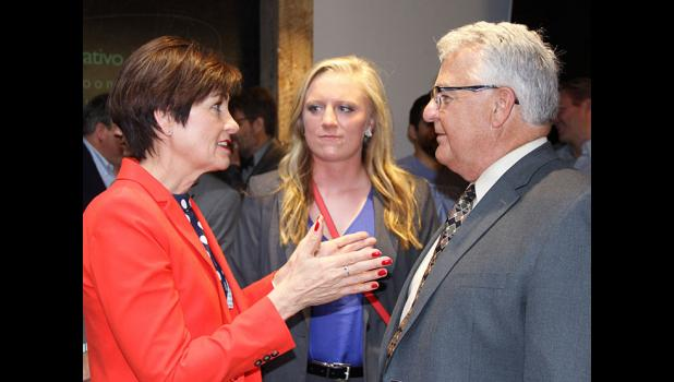 Gov. Kim Reynolds (left) speaks with Midland Power Cooperative's Norm Fandel and Kara Boyle during Pillar's celebration in downtown Des Moines. Fandel, president of Grow Greene County Gaming Corporation, the non profit associated with Wild Rose Jefferson, talked with Reynolds about the surge in economic-development activity in Jefferson and surrounding cities in recent years.