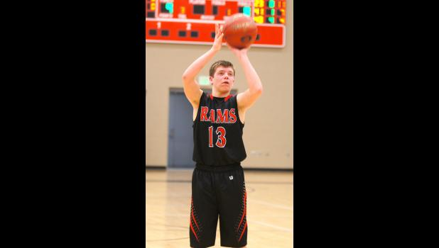 Freshman Trey Tucker prepares for one of his six free throw attempts in the Rams game versus Gilbert. Tucker scored 25 points, but the Rams lost the game 86-71.