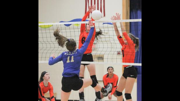 Paton-Churdan's Megan Carey (6) and Tessa Steimel (9) block Glidden-Ralston's Talia Schon (11) during the Wildcats' 3-1 win Tuesday in the first round of 1A, Region 3 action. BRANDON HURLEY | JEFFERSON HERALD