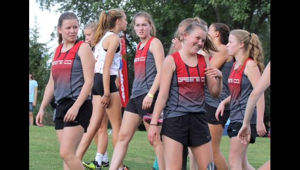 Greene County's Izzy Bravard (right) shares a laugh as teammates Tieryn Tucker (left) and Kirsten Lamoureux (middle) look on prior to the 44th annual Panorama Cross Country Invite Sept. 13th in Panora. BRANDON HURLEY | JEFFERSON HERALD