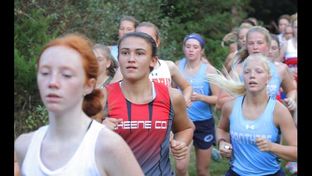 Greene County's Makala Kafer runs with a pack of athletes during the 44th annual Panorama Cross Country Invite Sept. 13 in Panora. Kafer placed 29th to help the Rams finish seventh overall as a team.  BRANDON HURLEY | JEFFERSON HERALD