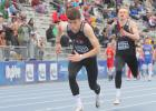 Greene County's Brent Riley (front) prepares to receive the baton from Carter Morton during the 4-by-100-meter relay prelims at the 2019 Drake Relays Saturday, April 27 in Des Moines. The Rams finished in a tie for 48th overall with a time of 44.92. BRANDON HURLEY | JEFFERSON HERALD