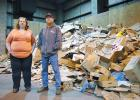 Just a normal day at Genesis Development: Ashley Coil (left) and Brandon Murphy, who oversee the recycling center at Genesis, want people to be more mindful of what they're leaving inside cardboard boxes. Increasingly, Genesis is getting stuck with plastic packing materials that can't be recycled. ANDREW McGINN   JEFFERSON HERALD PHOTOS