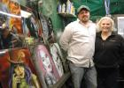 """I wasted my entire high school experience because I was doodling and drawing,"" says airbrush artist Tony Sims (left), pictured with wife Mandy inside his art studio in Dana. Maybe it wasn't such a waste after all: Sims is now making a name for himself painting motorcycles and selling work at comic conventions. ANDREW McGINN 