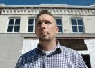 """It feels like home, and it did from the start,"" city building inspector and former police officer Nick Sorensen says of Jefferson. The Exira native has been at the forefront of the city's effort to acquire vacant commercial buildings and get them back onto the market, including the 123-year-old building at 205 N. Wilson Ave., which remains a work in progress. For years, the four upper-story windows were paneled over. ANDREW McGINN 