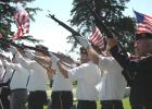 Members of Jefferson's American Legion Post 11 and Veterans of Foreign Wars Post 9599 fire a volley of shots Monday at the Jefferson Cemetery in observance of Memorial Day. ANDREW McGINN | JEFFERSON HERALD