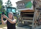 U.S. Sen. Joni Ernst, R-Iowa, shoots a selfie video Friday south of Jefferson for her online followers after spending part of the afternoon with James Holz and Bill Frederick, owners of Iowa Cover Crop. The Greene County-based business has been spreading the gospel of cover crops as a way to improve water quality. ANDREW McGINN   JEFFERSON HERALD PHOTOS