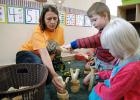 Annette Foster (left) does an activity with preschool students Bart Nicholson and Winnie Stott at Natural Wonders Learning Center on Westwood Drive. The new center opened last week. ANDREW McGINN | JEFFERSON HERALD