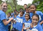 Isabella Schroeder (left) works with children at El Volcan school while in Honduras. Power Lift donated 140 T-shirts to a local church mission in August. CONTRIBUTED PHOTO