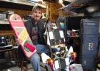 """Great Scott! Troy Powers holds both a nonworking replica he made of the hoverboard from """"Back to the Future Part II"""" (left) and the real thing that's under development in his garage. ANDREW McGINN 