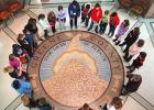Fifth-grade students from teacher Kim Braun's class at Greene County Middle School listen Tuesday morning as tour guide Jean Van Gilder (top center) talks about the ceramic mosaic in the rotunda of the Greene County courthouse. Local students from all schools took guided tours of the courthouse throughout the week to observe the building's centennial. ANDREW McGINN | JEFFERSON HERALD PHOTOS