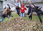What fun is raking leaves if you're not going to jump into them at some point? Greene County High School students (from left) Serenity Blair, Janelle Brophy, Caytlyn Adamson, Kara Reed and Kolton Showers take the leap Nov. 2 in a yard on West Washington Street. The high school has kept a good thing going now for 20 years. What started in 1997 with the school's Interact Club raking 15-20 yards has turned into an afternoon of service for the student body and staff. Students on Nov. 2 raked 134 total yards in