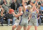 Paton-Churdan's Carmyn Paup (14) peaks around a throng of Glidden-Ralston defenders during the Rockets' come-from-behind 49-38 win Feb. 18 in a Class 1A regional semifinal in Churdan.  BRANDON HURLEY | JEFFERSON HERALD