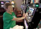 Bonnie Burkhardt, of Jefferson, tries her luck Monday on a slot machine at Wild Rose Jefferson. The casino opened as part of an unadvertised soft opening.
