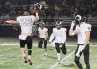 Greene County captured its first playoff victory in GCHS history with a 35-21 win over Des Moines Christian Friday, Nov. 1 in the 2A first round. Greene County's Nick Breon (23), Joe Patterson (38) and Colby Kafer (2) celebrate the monumental moment.  BRANDON HURLEY | JEFFERSON HERALD