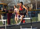 Daric Whipple clears one of the ten hurdles in the 400 meter low hurdle race at Winterset on April 3. Whipple won the race in 59.96 seconds.