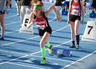 Eme Johnson bursts out of the blocks for Greene County's shuttle hurdle relay team when they ran at the Drake Relays on April 26.