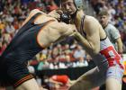Challen battles with Solon's Cole Fritz in a consolation match at the state wrestling meet on Saturday. Challen won the match 10-9.