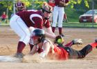 Junior Kayla Mobley slides safely back to third as South Hamilton attempts to pick her off base. Mobley connected for a single and a double in the game.