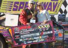 Devin Smith from Lake City is pictured after he won the Race of Champions at the Super Nationals in Boone last weekend. Smith also won the feature event in the stock car division and is pictured with his wife Brooke (Wanniger) Smith who is the daughter of Joe and Jill Wanniger of Jefferson.