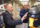 Congressman Steve King (left) examines a set of shoulder pads manufactured at AAI in Jefferson with vice president of operations Mark Lane during a tour of the 250,000-square-foot Jefferson operation.