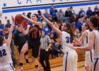 Carleigh Paup driving to the basket was a familiar sight at Paton-Churdan games this year. Paup's 25.2 points per game scoring average led the conference and was first in Class 1A among players who had played in at least 12 games this season.