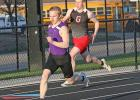 South Central Calhoun's Ben Englin (front) leads Greene County's Nathan Wailes (back) during the 400 meter dash event held April 12 at the Carroll Co-Ed meet. Wailes finished second.  MARK SCHAFER | CARROLL TIMES HERALD