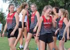 Greene County's Izzy Bravard (right) shares a laugh as teammates Tieryn Tucker (left) and Kirsten Lamoureux (middle) look on prior to the 44th annual Panorama Cross Country Invite Sept. 13th in Panora. BRANDON HURLEY   JEFFERSON HERALD
