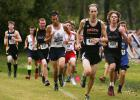 Levi Kiss (480) of Paton-Churdan stays at the front of the pack last Thursday at the Greene County Cross Country Invitational. He completed the race in 19:41, good for 40th place.
